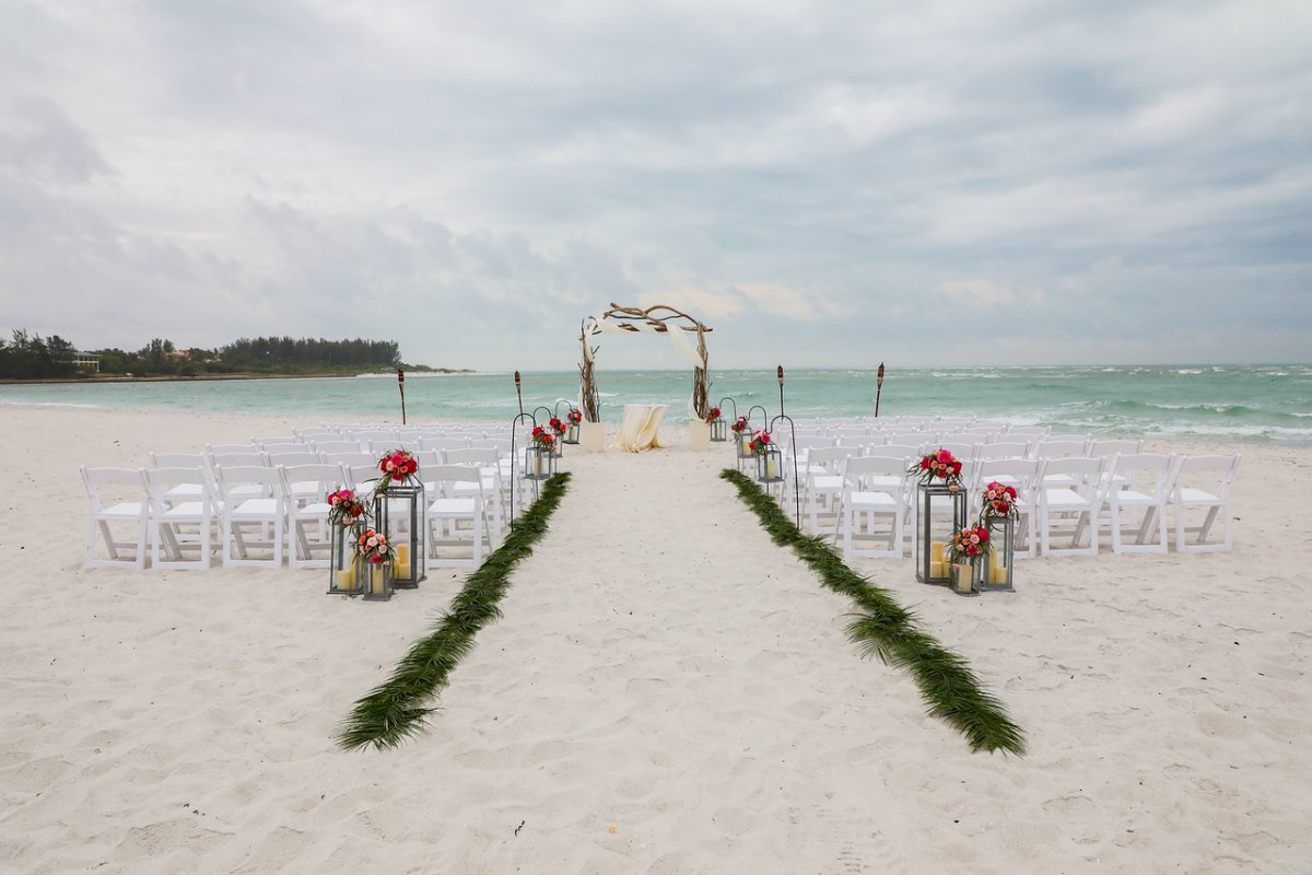 Ceremony Site on Beach with Lanterns and Palm Fronds