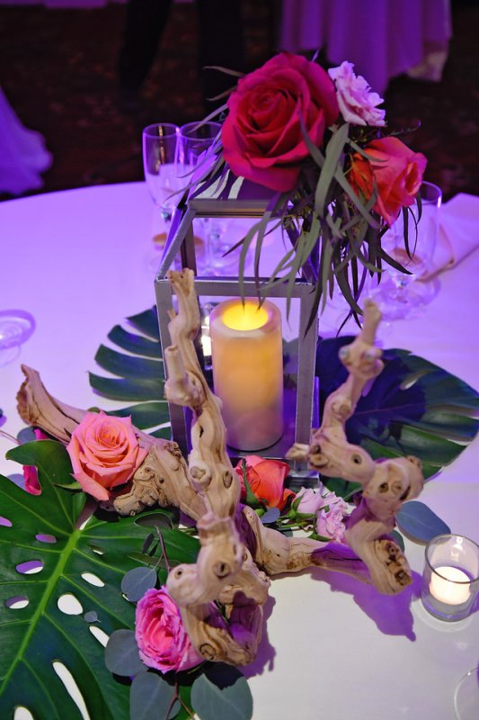 Table Centerpieces with Lanterns Monstera Leaves and Ghost Wood
