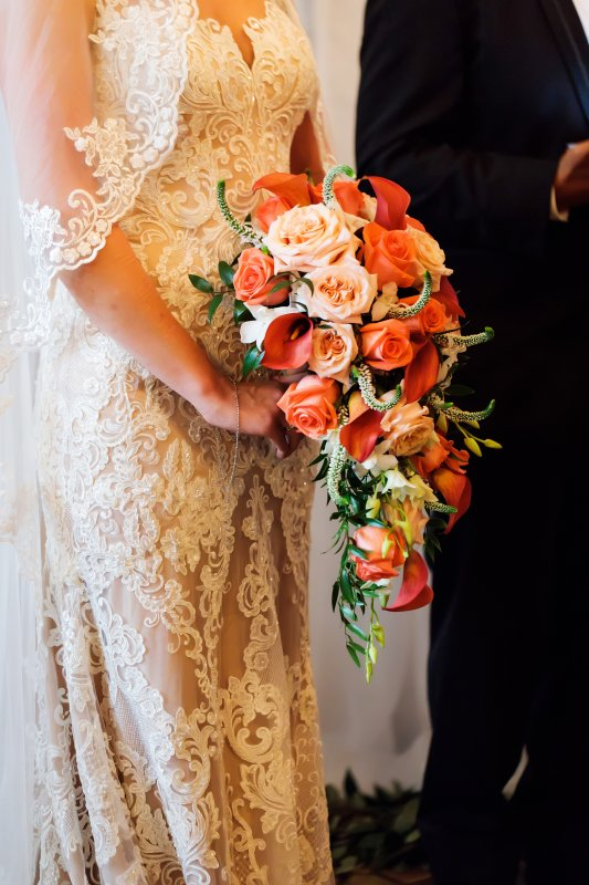 Cascading Bridal Bouquet of Mini Calla Lilies, Coral Roses, Shimmer Garden Roses, and Orchids