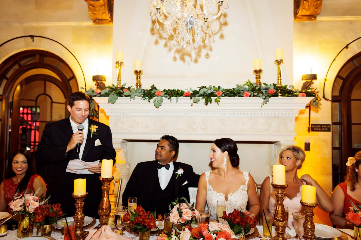 Head Table with Gold Candles, Flowers, and Mantle