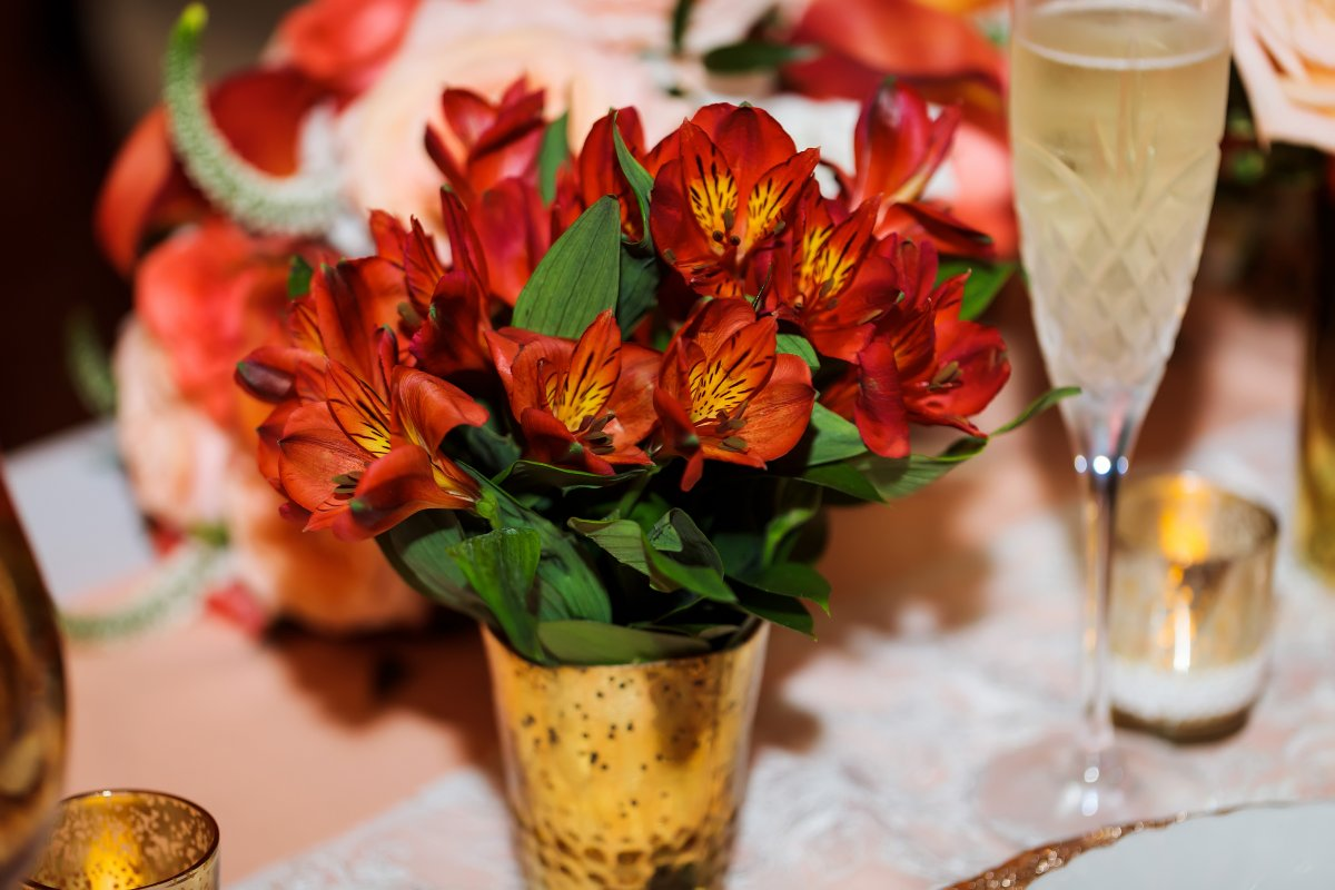 Red Alstroemerie or Peruvian Lilies in Gold Vases on Head Table