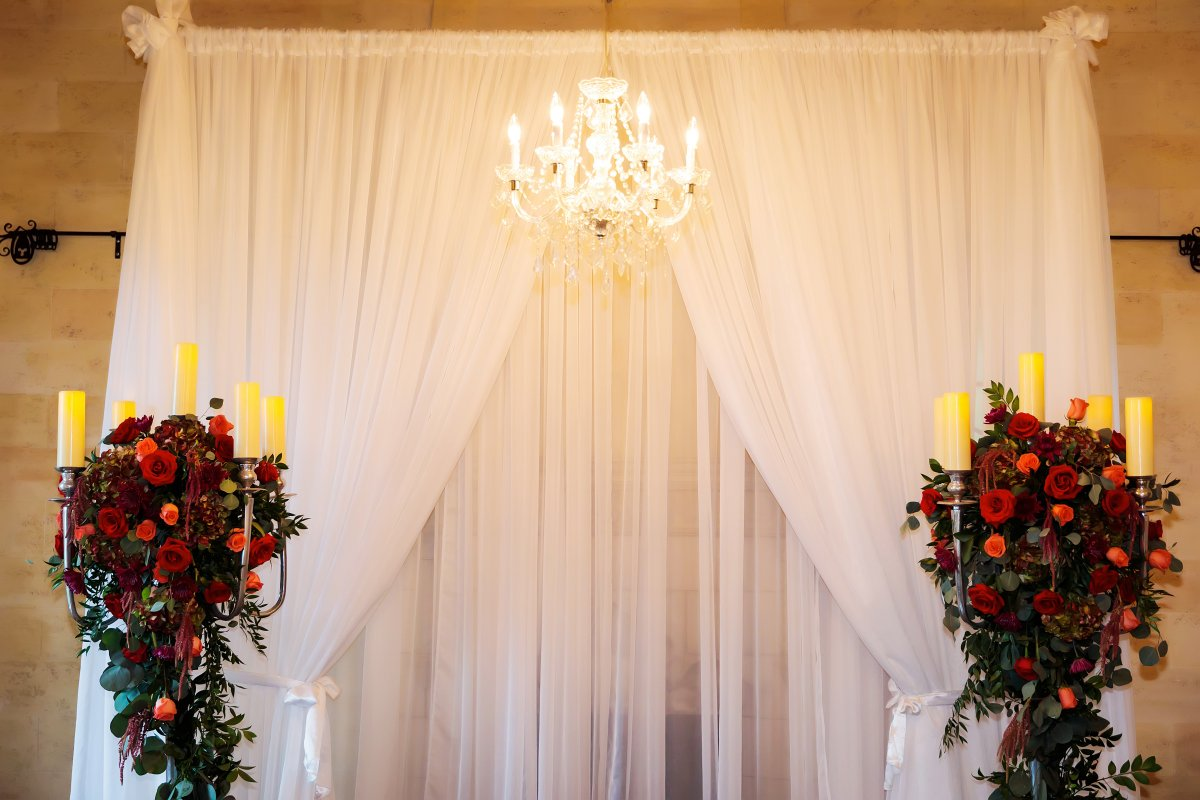 Silver Candelabras with Flowers and Greens to Frame Ceremony Site