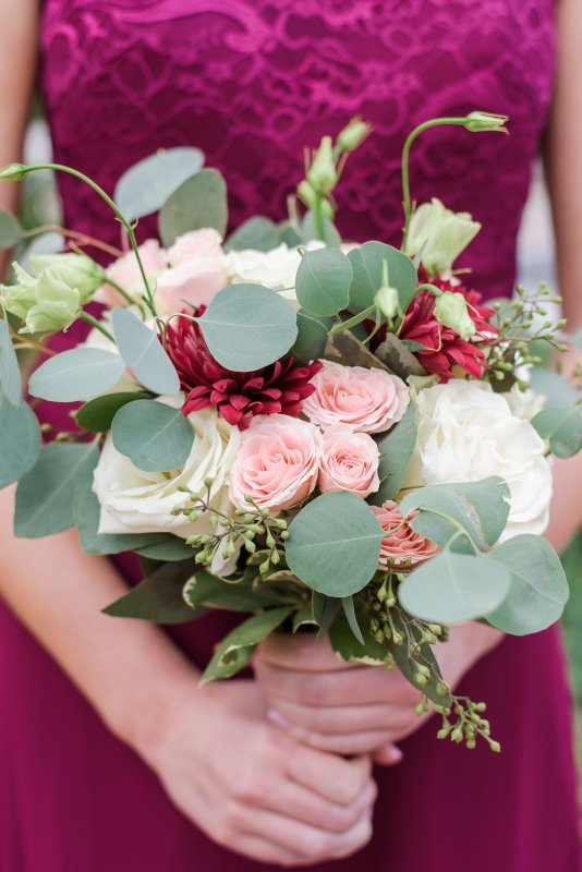 Garden Like Bridesmaids Bouquets featuring Burgundy Dahlias, Silver Dollar Seeded Eucalyptus, Blush Spray and Cream Roses, Lizianthus