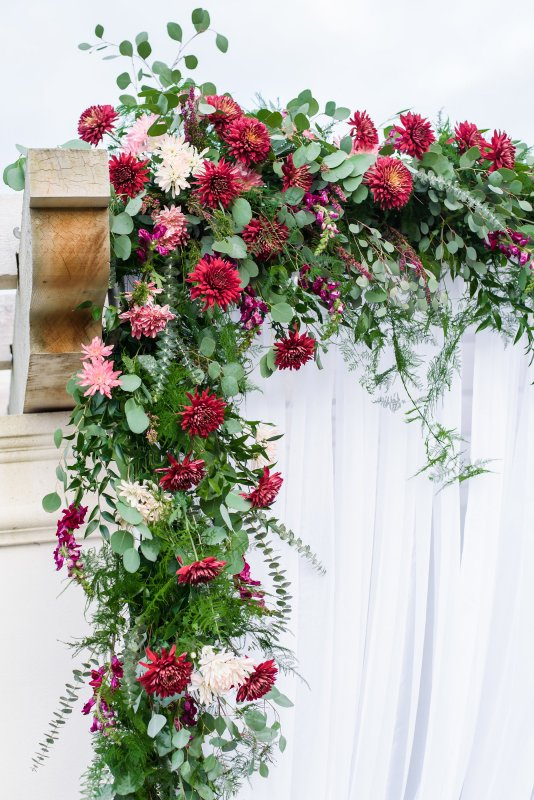 Close Up of Flowers on the Pergola in Burgundies, Blush, and Creams with Lots of Lush Greenery