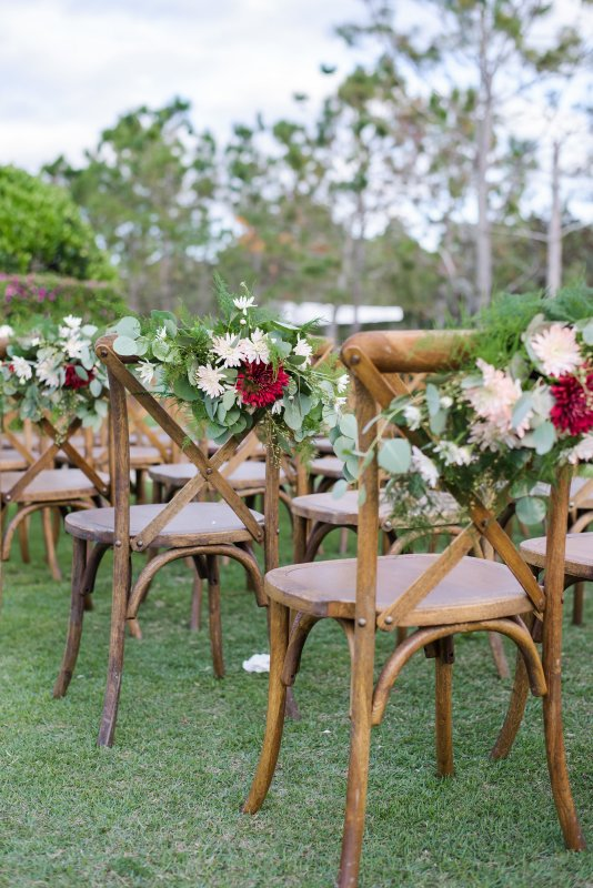 Florals on Aisle Chairs for Wedding Ceremony