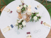 Top View of Guest Table with 3 Gold Pillar Candles and 3 Gold Containers