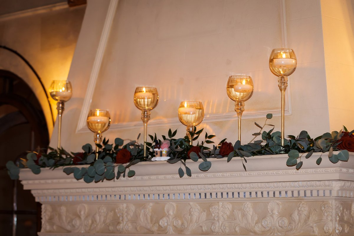 Mantle with Gold Candle Holders with Greens and Roses