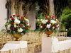 2 Gold Urns at back of aisle filled with willow and burgundy and blush flowers, sunflowers