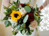 Close-Up of Bridal Bouquet with Sunflowers,  quicksand roses, explorer roses, burgundy mini calla, veronica, and seeded silver eucalyptus