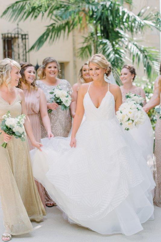 Captivating Shot of Bride with Bridesmaids with Bouquets