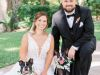 couple-w-dogs-of-honor-with-orchid-wreath-collars