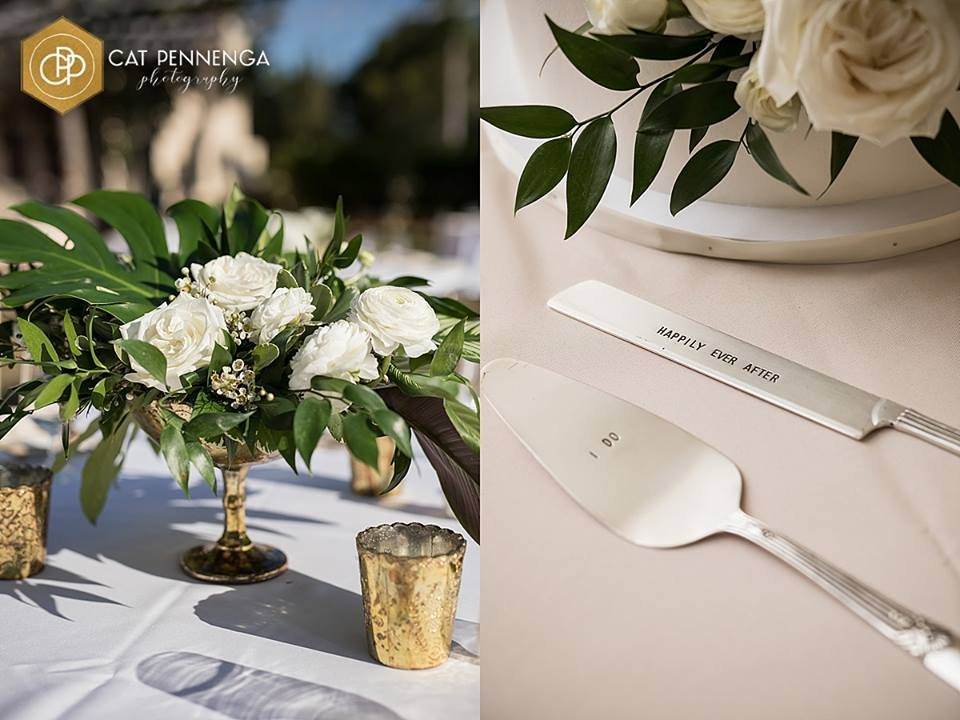 Guest Tables with Footed Gold bowl with Tropical leaves and white flowers and White Flowers on Cake
