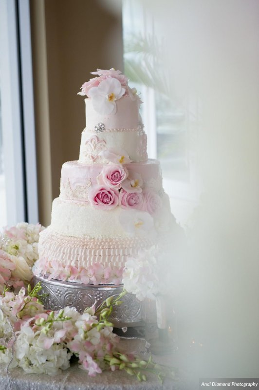 Beautiful Wedding Cake with Re-purposed flowers from Aisle flowers from Ceremony
