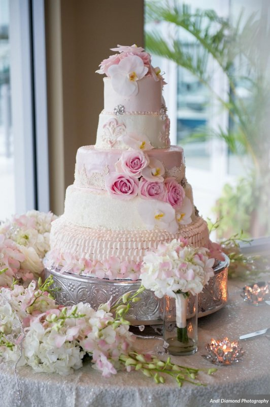 Wedding Cake with Pink Flowers and Toss Bouquet