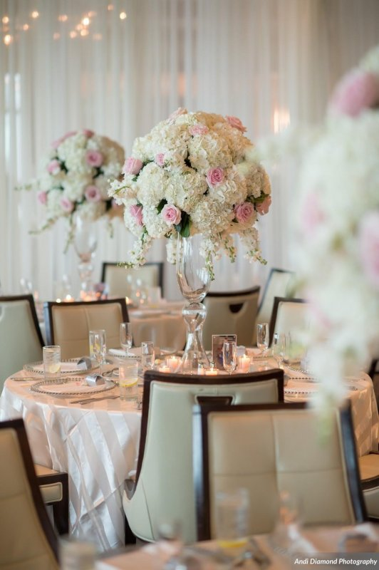 Elevated Arrangements of  Pink and White Roses with White Hydrangea