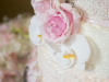 Close up on Wedding Cake Details with Orchids and Roses