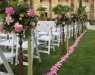 Aisle lined with flower arrangements