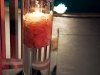 cylinder-with-rose-petals-and-floating-candles
