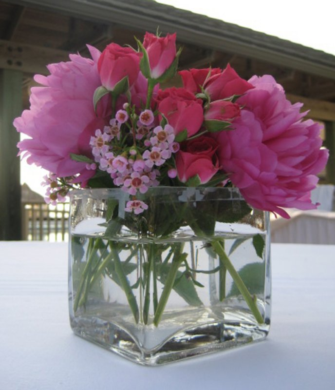Pink peonies and rose arrangement for wedding