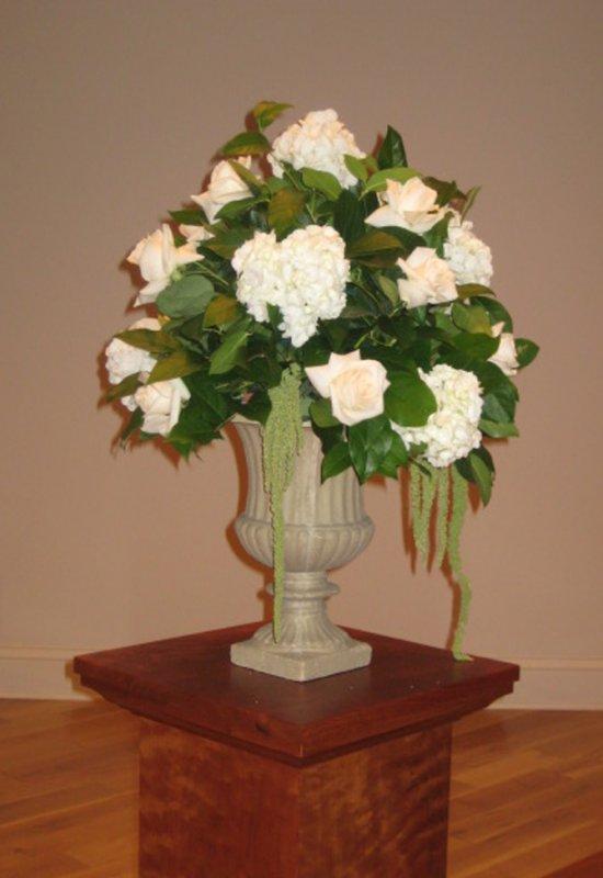 Wedding urn in white flowers