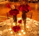 Ritz ballroom with candle light and elevated centerpieces