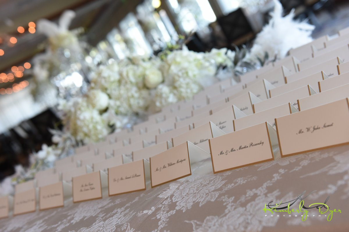 Place card table with low spray roses hydrangea and orchids