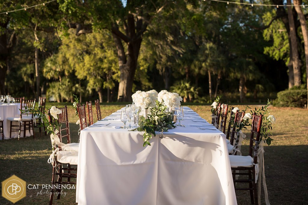 Head Table with Green Garland and Roses