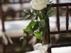 Single Mondial Garden Roses with Ruscus on Ends of Chairs on Aisle