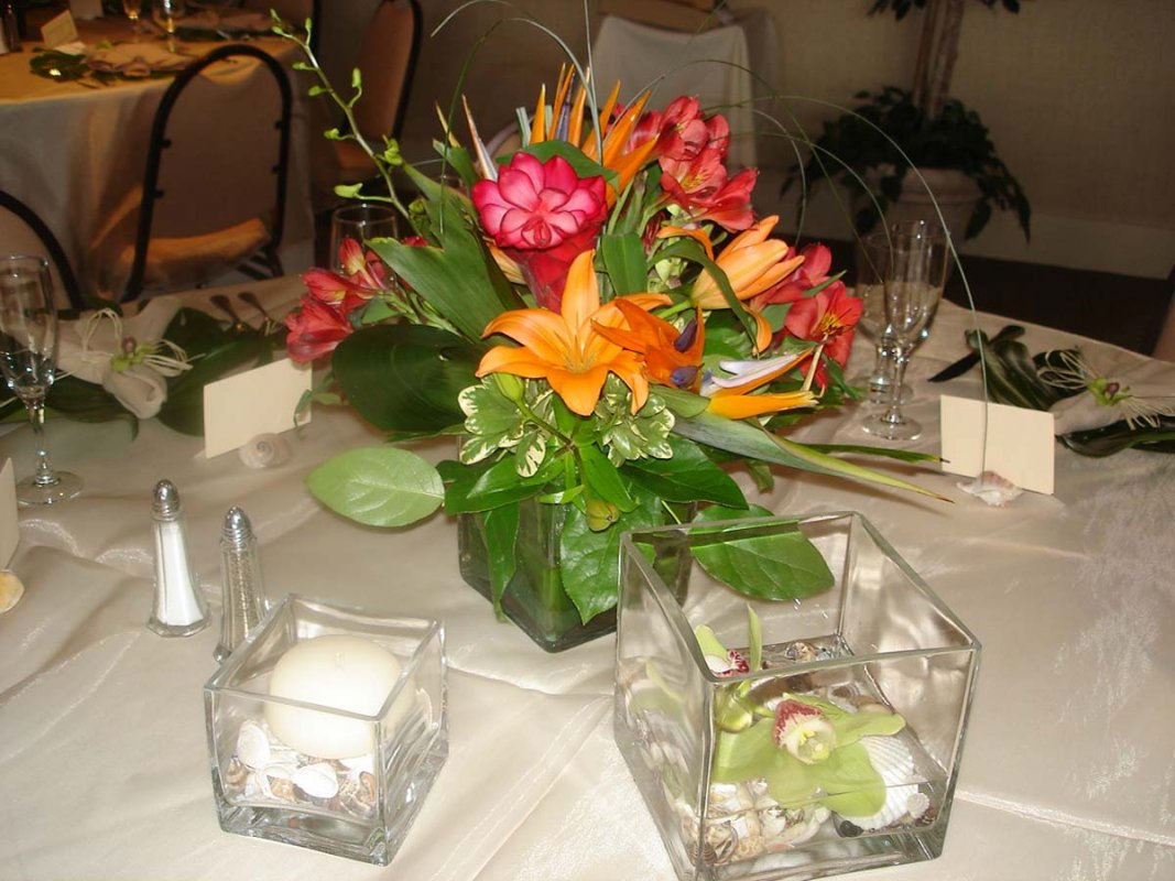 Siesta key wedding beautiful tropical theme sarasota for Floral wedding decorations ideas