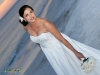 bride-on-beach-all-white-bq-with-blue-hydra