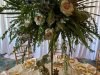 gold-tri-pod-used-elevation-loads-of-greenery-thistle-cactus-at-the-base