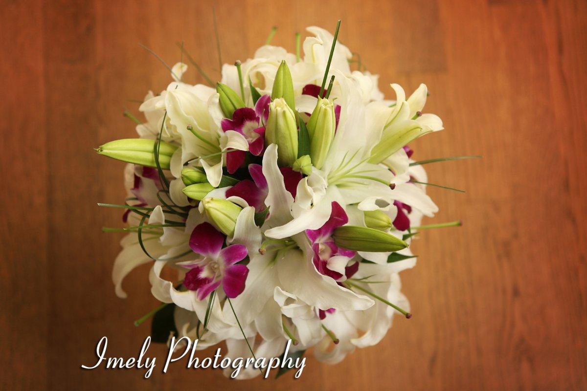 White lily purple orhcid bridal bouquet