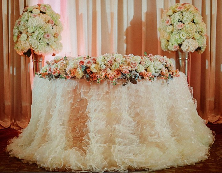 Sweetheart Table Edged with Flowers on Silver Trumpets