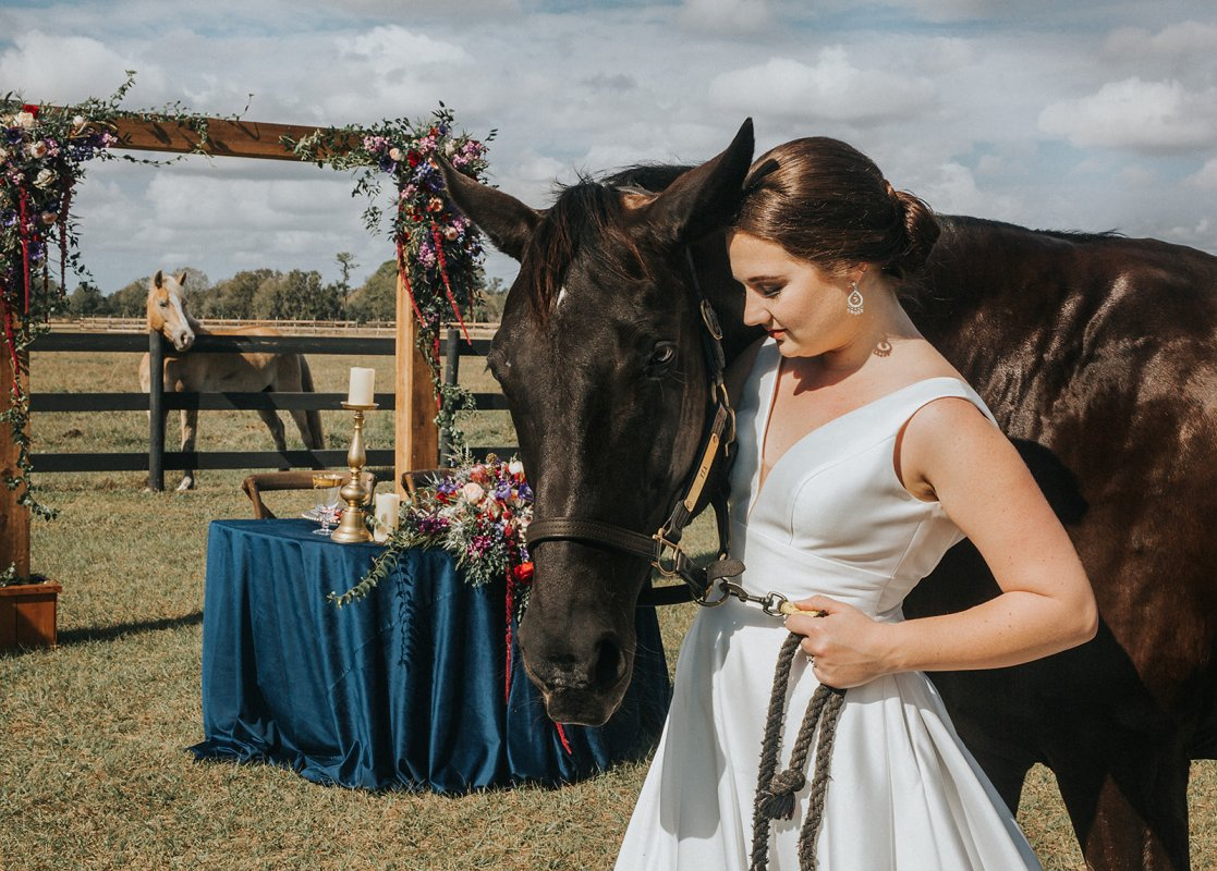 Bride with Horse and Sweetheart Table in Background