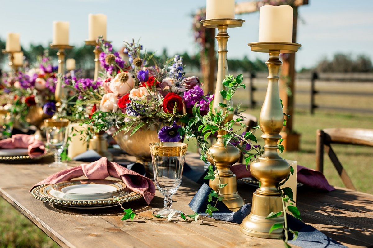 Close-Up of Guest Table Centerpiece and Gold Candles