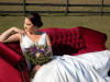 Bride with Bouquet on Red Velvet Sofa