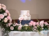 Cake Table with Back of Aisle Flowers and Flowers from Gazebo
