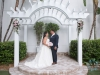Bride and Groom under Gazebo with Pink Floral Sprays