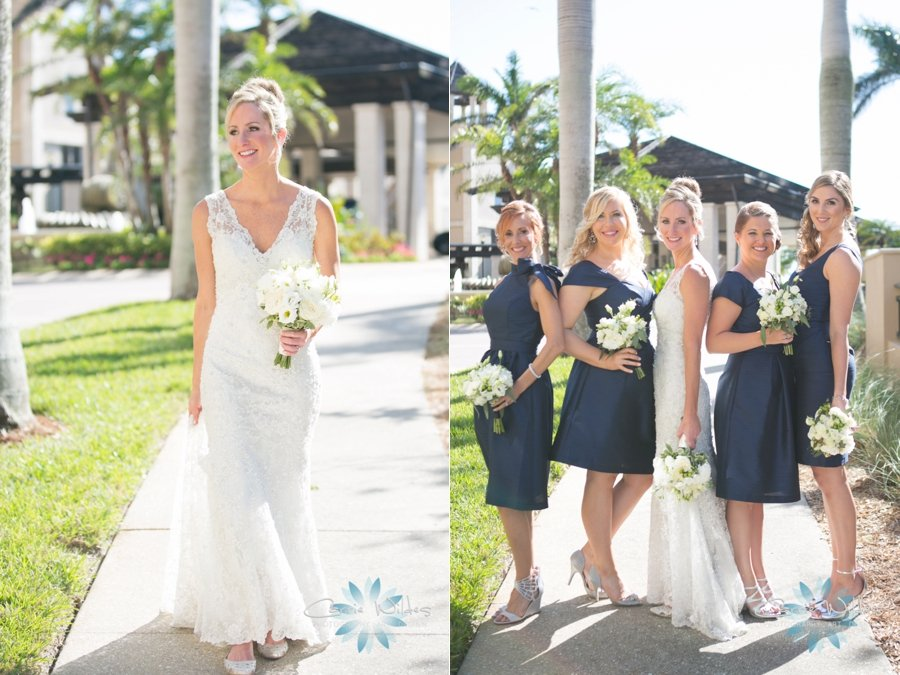 Bridesmaids in Navy with All-White Flowers