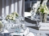 Bridesmaids Bouquets in Silver Vases on Head Table