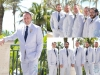 Groom and Groomsmen in Seersucker Suits with Starfish Boutonnieres