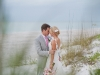 Bridge and Groom on the Beach with pink bouquet