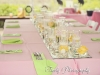 Feasting table with mirrored runner, pink and yellow flowers