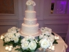 wedding cake with white mondial roses