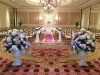 Wedding aisle with petals, urns, and chuppah