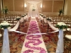wedding aisle with flower petal scroll design