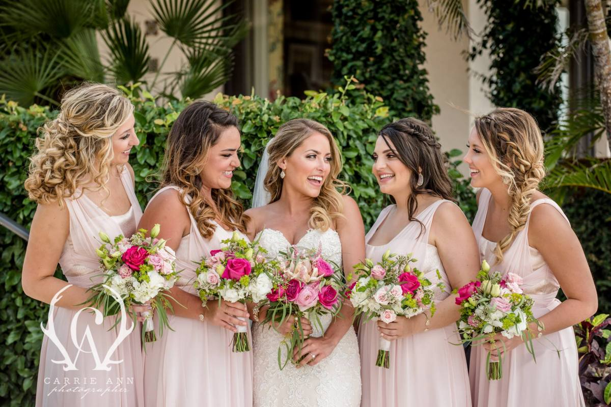 Bride with Bridesmaids featuring pink flowers
