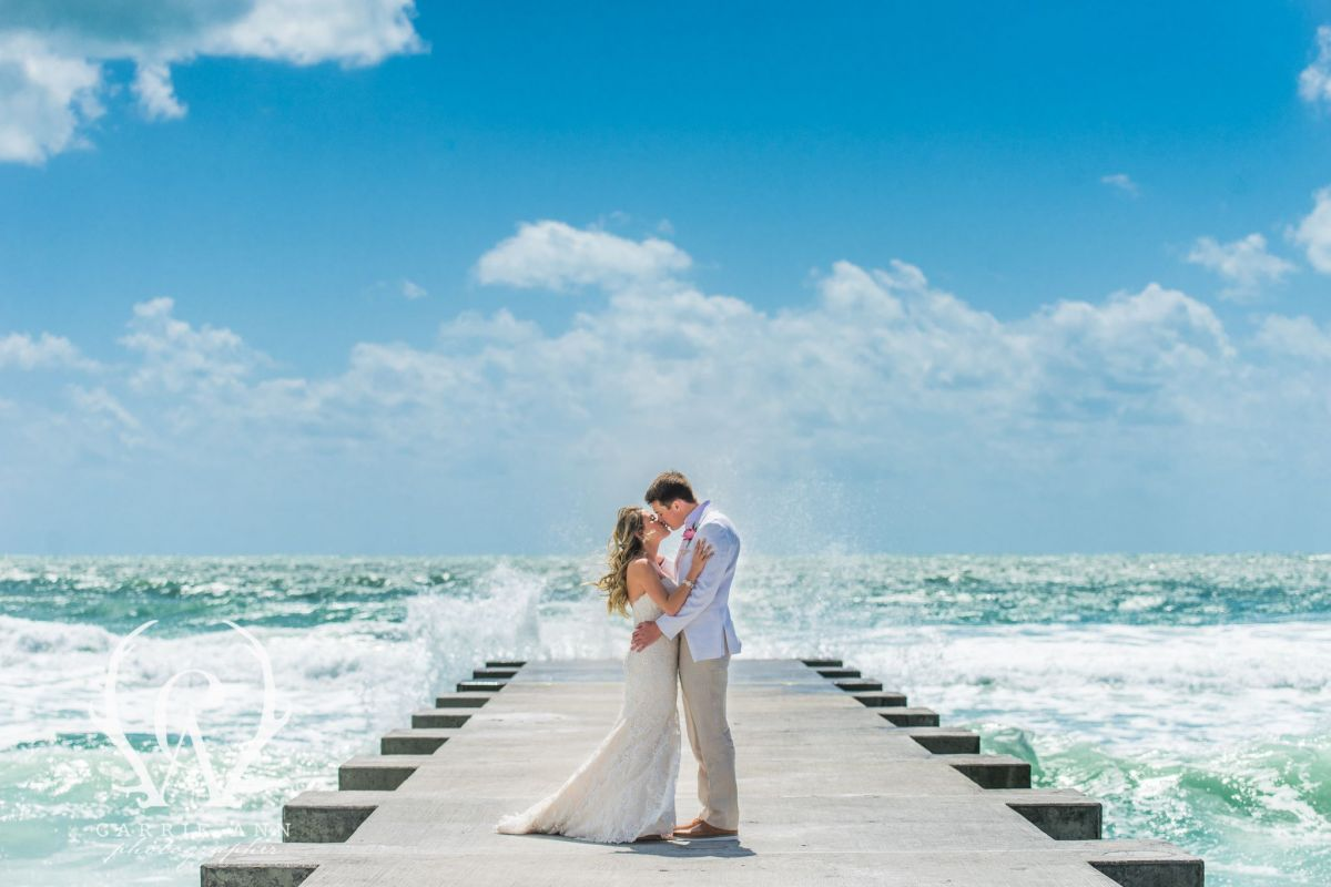 Bride and Groom on Dock with Water Background