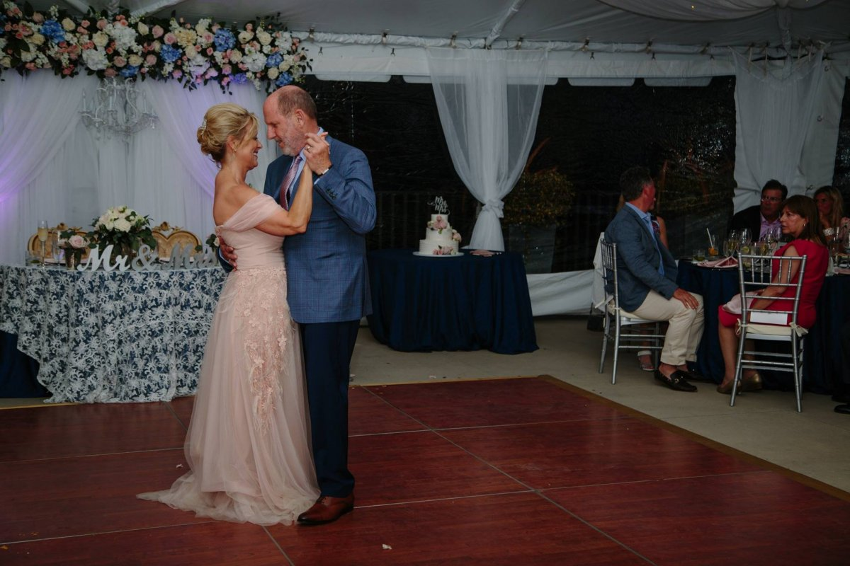 Cake with Flowers with Bride and Groom on Dance Floor
