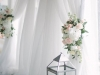 Flowers on Arch with Draping and Lanterns at Base